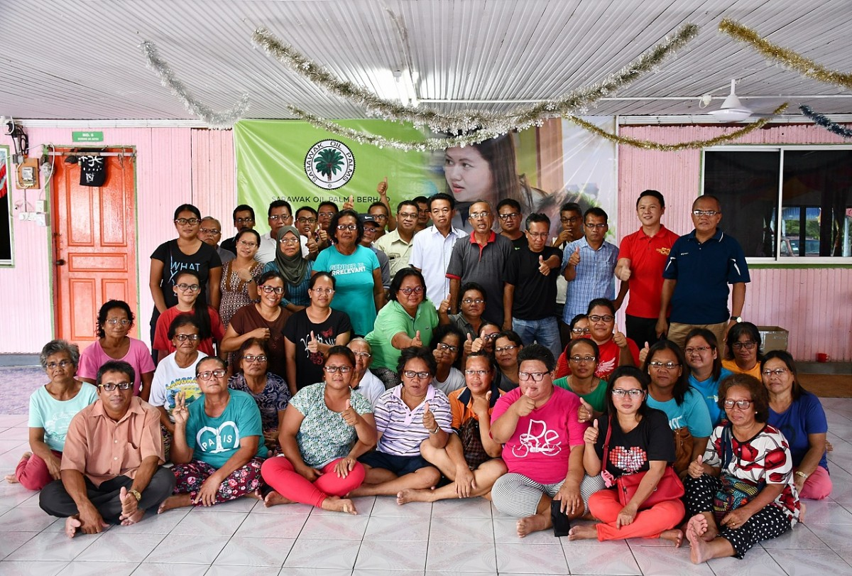 Representatives of SOPB join the longhouse villagers in a group photo at Rumah Buli Anak Jamit, Sungai Semanok in Kuala Tatau